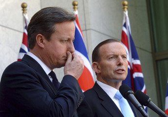British Prime Minister Cameron and Australian Prime Minister Abbott hold a joint news conference at Parliament House in Canberra