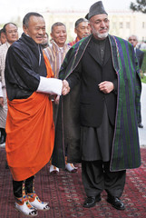 Afghanistan's President Hamid Karzai shakes hands with Bhutan's Prime Minister Jigmi Y. Thinley during a meeting at the presidential palace in Kabul