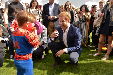 Britain's Prince Harry talks to children at a tea party at Buckingham Palace, London