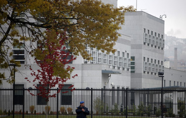 A policeman stands in front of the U.S. embassy in Sarajevo