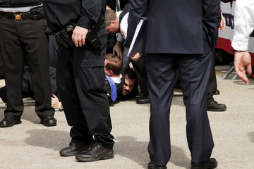 U.S. Secret Service agents detain a man after a disturbance as U.S. Republican presidential candidate Trump spoke at Dayton International Airport in Dayton, Ohio