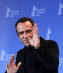 """Director Pitts poses during photocall to promote movie """"Shekarchi"""" in Berlin"""