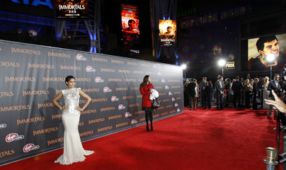 "Pinto poses at the world premiere of ""Immortals"" at Nokia theatre in Los Angeles"