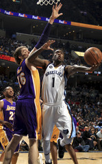 Memphis Grizzlies' Wroten shoots against the defense of Los Angeles Lakers' Gasol during their NBA basketball game in Memphis