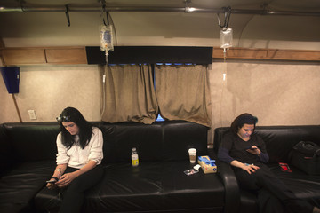Meredith Koko and Nena Kallopoulos receive vitamin infusion via intravenous drips on the Hangover Bus in the Manhattan borough of New York