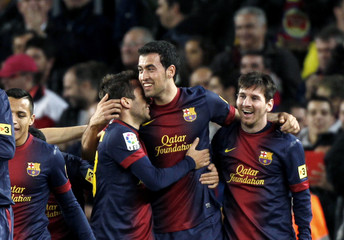 Barcelona's Busquets celebrates his goal with team mate Alba and Messi against Atletico Madrid during their Spanish first division soccer match in Barcelona