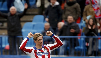 Atletico Madrid's Torres celebrates after scoring a goal against Getafe during their Spanish first division soccer match in Madrid