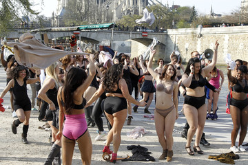 """Women in their underwear dance during a flash-mob named """"beautiful naked"""" organised by French TV M6 in front the Notre Dame Cathedral in Paris"""