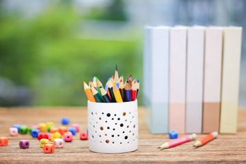 Stock Photo - Color pencils in the box on the table