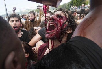 A man dressed up as a Viking drinks local red wine during the annual Viking festival of Catoira in north-western Spain