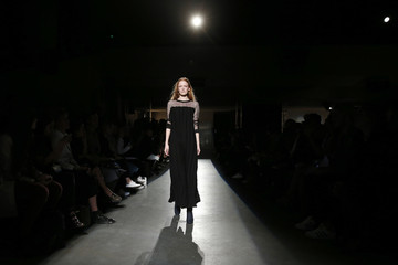 A model presents a creation by German designer Lutz Huelle as part of his Spring/Summer 2016 women's ready-to-wear fashion show in Paris