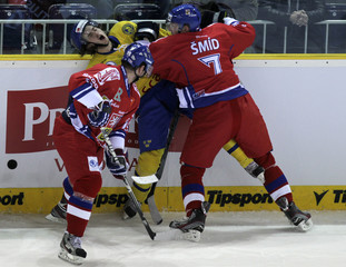 Czech Smid and Tlusty collide with Sweden's Jarnkrok during their Euro Hockey Tour ice hockey match in Liberec
