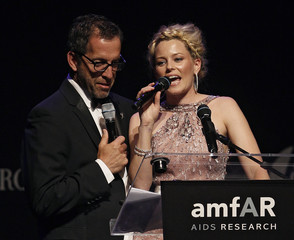 AmfAR Chairman Kenneth Cole and actress Elizabeth Banks attend the auction of the amfAR's Cinema Against AIDS 2010 event in Antibes during the 63rd Cannes Film Festival