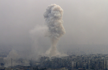 Smoke rises after airstrikes on rebel-controlled besieged eastern Aleppo