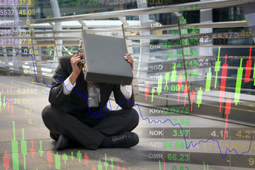 Businessman is disappointed from losing in stock exchange, economic crisis concept