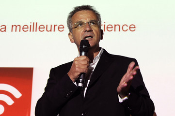 SFR CEO Franck Esser attends a news conference to announce the company's new mobile phone tariffs in Paris