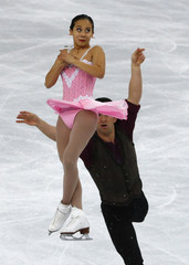 Zhang and Bartholomay of the U.S. during pairs short program at the Sochi 2014 Winter Olympics