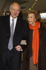 L'Oreal chief executive Jean-Paul Agon and Liliane Bettencourt, heiress to the L'Oreal fortune arrive for the L'Oreal-UNESCO prize for women in Paris