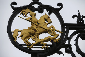 The gold leaf logo of St. George slaying the dragon is seen on the entrance gate of Sankt Georgen Graduate School of Philosophy and Theology in Frankfurt