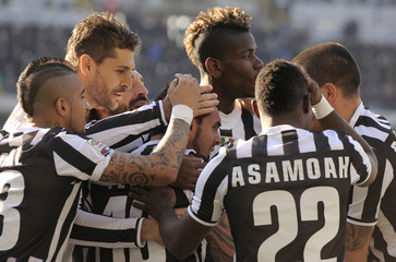 Juventus' Tevez celebrates with his teammates after scoring against Hellas Verona during their Italian Serie A soccer match in Verona