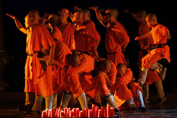 """A Shaolin monk performs at a show titled """"The Wheel of Life """" in Amman"""