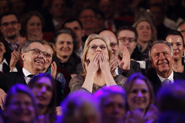U.S. actress Streep reacts next to Berlinale festival director Kosslick during an award ceremony at the 62nd Berlinale International Film Festival in Berlin