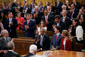 U.S. President Obama receives a standing ovation in the House of Commons on Parliament Hill in Ottawa