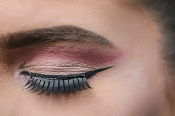Stage make up, close up of an eye closed with fake eye lashes