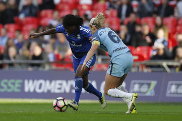 Manchester City's Steph Houghton and Birmingham's Freda Ayisi in action