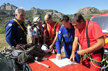French gendarmes and firemen special unit study a map before a patrol in Roquebrune-sur-Argens