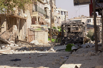 A view shows damaged buildings after clashes between Free Syrian Army fighters and regime forces in the Seif El Dawla neighbourhood of Aleppo