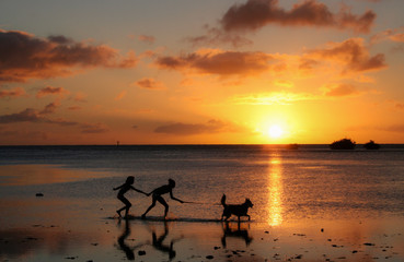 Girls at sunset with dog