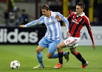 AC Milan's De Sciglio fights for the ball with Malaga's Joaquin during their Champions League Group C soccer match in Milan