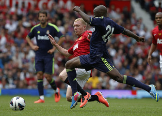 Manchester United's Paul Scholes challenges Real Madrid's Claude Makelele during a legends charity soccer match at Old Trafford