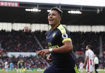 Arsenal's Alexis Sanchez celebrates scoring their third goal