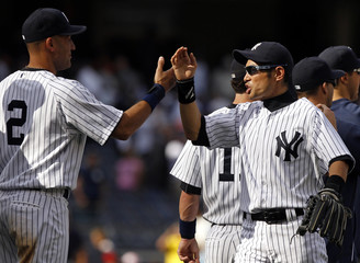 New York Yankees Jeter and Suzuki celebrate their win against Tampa Bay Rays in their MLB American League baseball game in New York