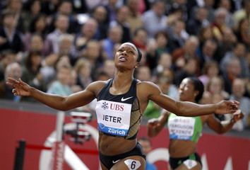 Carmelita Jeter of the U.S. reacts after winning the women's 200 metres event at the IAAF Diamond League athletics meeting in Zurich