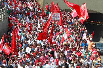 Demonstrators carry flags and banners during a march organised by FENASOL and the Lebanese Communist party to mark Labour Day in Beirut, Lebanon