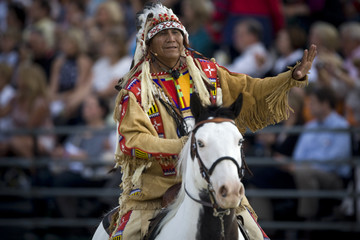 A native American chief departs after blessing the games during the opening ceremony at the World Equestrian Games in Lexington