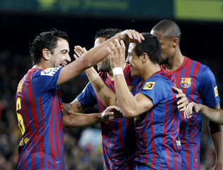 Barcelona's  Xavi, Cesc and Abidal celebrate Alexis Sanchez's goal against Levante UD during Spanish first division soccer match at Nou Camp stadium in Barcelona
