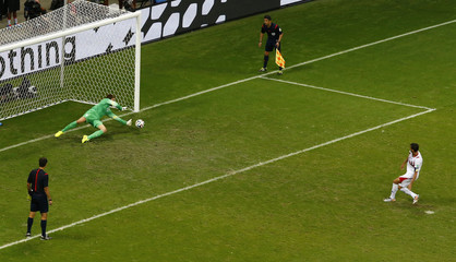 Goalkeeper Krul of the Netherlands makes a save from Costa Rica's Ruiz during a penalty shootout in their 2014 World Cup quarter-finals in Salvador