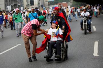 Demonstrators protest against Venezuela's President Nicolas Maduro's government in Caracas, Venezuela