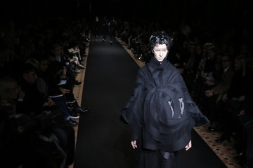 A model presents a creation by Japanese designer Junya Watanabe as part of his Fall/Winter 2014-2015 women's ready-to-wear collection during Paris Fashion Week