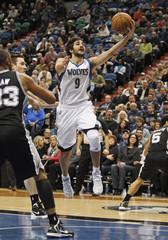 Minnesota Timberwolves' Rubio makes layup against San Antonio Spurs' Diaw during their NBA basketball game in Minneapolis