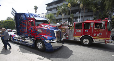 "Fire engine drives by ""Autobot Optimus Prime"" truck from the movie ""Transformers: Age of Extinction"" during a pick-up in West Hollywood"