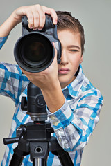 Boy with camera taking pictures