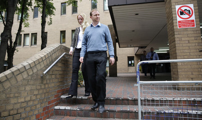 Former trader Tom Hayes and his wife Sarah leave Southwark Crown Court in London