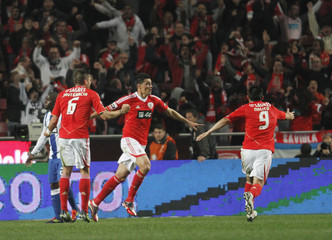Benfica's Oscar Cardozo celebrates his goal against Porto during their Portuguese Premier League soccer match at Luz stadium