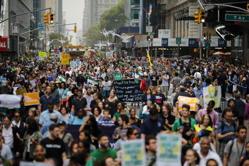 People march during a rally against climate change in New York