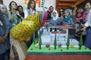 Nobel Peace Prize laureate Malala Yousafzai blows out candles on her birthday cake at a school for Syrian refugee girls, built by the NGO Kayany Foundation, in Lebanon's Bekaa Valley